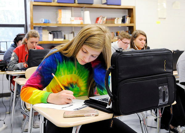 Don Knight | The Herald Bulletin<br /> Sydney Tucker works on a handout in her English class at Frankton on Friday. Frankton and Elwood Jr.-Sr. High Schools were included on the list of Indiana's best public schools by U.S. News and World Report.