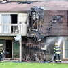 John P. Cleary |  The Herald Bulletin<br /> Firefighters put out hotspots after getting a structure fire under control in the 4600 block of State Road 32 East in Chesterfield Monday morning.