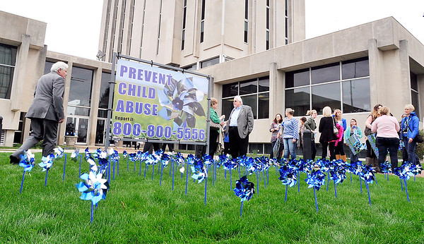 John P. Cleary |  The Herald Bulletin<br /> The kick-off of Prevent Child Abuse Awareness Month in Madison County included the planting of a pinwheel garden on the front lawn of the Anderson City Building Monday.