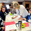 John P. Cleary |  The Herald Bulletin<br /> Kim Vermillion, Jane Pauley Health Center, Heather Morrow, Kleenco, Andrea Stafford and Missy Abernathy, both from Alexandria Community Schools, work in a small group doing an exercise on student skills mapping Monday as part of a meeting of Alexandria schools and community members to work on a plan for a grant from Lilly Endowment.