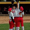 Mark Maynard   for The Herald Bulletin<br /> Frankton Eagles outfielders Brooke Campbell, Ryan Shively and Aleyah Rastetter show their spirit by raising their gloves together during their game against the Alexandria Tigers.