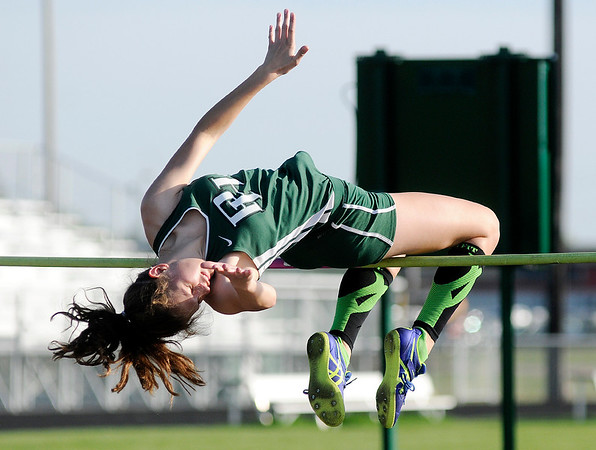 Don Knight | The Herald Bulletin<br /> Pendleton Heights Marisa Marshall clears five feet four inches to win the high jump during the Arabians Girls Track Invitational on Tuesday.