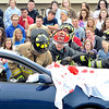 John P. Cleary |  The Herald Bulletin<br /> Lapel/Stony Creek Fire Department personnel work to extricate this person from the car in this mock accident scene as Lapel High School students watch.  Lapel High School held a drunk driver education awareness program Friday complete with a fatal car crash.