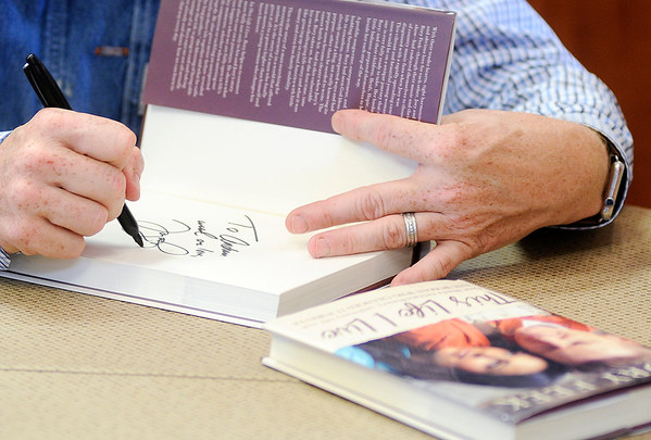"Don Knight | The Herald Bulletin<br /> Rory Feek signs his book ""This Life I Live"" at Gaither Family Resources in Alexandria on Saturday."