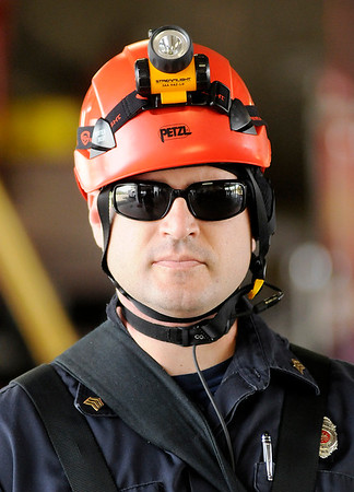 Don Knight | The Herald Bulletin<br /> Tony Malon demonstrates equipment used by the Anderson Fire Department's technical rescue team on Wednesday.