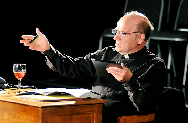 "John P. Cleary |  The Herald Bulletin<br /> Father Tim Farley (Bill Malone) tries to help a idealistic seminary student in the<br /> Commons Theatre's production of ""Mass Appeal."""