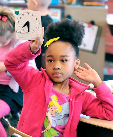 John P. Cleary    The Herald Bulletin<br /> Nayvia Moore holds up her clock with the right setting as her and her classmates in Karen Griner's first-grade class at Valley Grove Elementary School work on telling time.