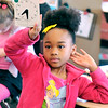John P. Cleary |  The Herald Bulletin<br /> Nayvia Moore holds up her clock with the right setting as her and her classmates in Karen Griner's first-grade class at Valley Grove Elementary School work on telling time.