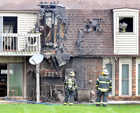 John P. Cleary |  The Herald Bulletin<br /> Firefighters check over the damage after battling a structure fire in the 4600 block ofState Road 32 East in Chesterfield Monday morning.