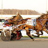 Don Knight | The Herald Bulletin<br /> Outlaw Secret Weapon (7) driven by Tyler Smith passes Musashi (3) driven by Ross Leonard for the lead and win in the third race on opening night of the live racing season at Hoosier Park on Saturday. The live racing season runs through November 17th.