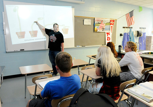 Don Knight | The Herald Bulletin<br /> Biology teacher Brett Sanders teaches his students about how ethylene causes a seedling bend at Frankton on Friday. Frankton and Elwood Jr.-Sr. High Schools were included on the list of Indiana's best public schools by U.S. News and World Report.