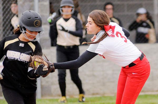 Don Knight | The Herald Bulletin<br /> Frankton's Sarah Stanley tags Madison-Grant's Maddi Evans out after fielding Evan's bunt as the Argylls hosted the Eagles on Thursday.
