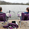 John P. Cleary |  The Herald Bulletin<br /> Joe Kelley and Bethany Bratton, both of Anderson, enjoy a relaxing day fishing off the end of the Shadyside Lake pier Monday afternoon with the warmer temperatures and calm waters hoping to catch a big one.
