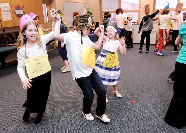 Don Knight | The Herald Bulletin<br /> Students perform a Russian folk dance during Frankton Elementary's World's Fair on Thursday.