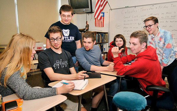 John P. Cleary |  The Herald Bulletin<br /> From left, Anderson High School student Lexie Heruth checks her answer as Wesley Erny, Joe Kirkpatrick, James Brandon, Lauren Caldwell, Brody Pickering, and Jordy Brouse look on as they prepare to compete in the Clemson University Calculus Challenge. They along with six other members of the Anderson High School math team will go against other high school students from across the country this weekend.