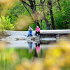 John P. Cleary |  The Herald Bulletin<br /> The budding foliage of spring help frame these folks as they enjoy a nice afternoon sitting along the water at Shadyside Park Monday.