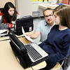 Don Knight | The Herald Bulletin<br /> Frankton math teacher Eric Stayer goes over a math problem with Alivia Pierce as Ana VanHoover works on her laptop on Friday. Frankton and Elwood Jr.-Sr. High Schools were included on the list of Indiana's best public schools by U.S. News and World Report.