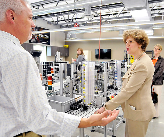 John P. Cleary    The Herald Bulletin<br /> Jeff Heiking, a mechanical engineering professor with Purdue, explains to Rep. Susan Brooks how they use this SMC training HAS-200 system in their mechatronics lab during her tour of the Purdue Polytechnic facility Monday.
