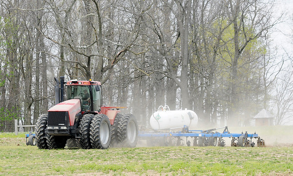 Don Knight | The Herald Bulletin<br /> A farmer applies anhydrous ammonia to a field on County Road 200 West on Wednesday.