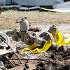 Don Knight | The Herald Bulletin<br /> Pieces of two inch gas line lie on the ground at the scene of an accident  on Washington Street in Alexandria.