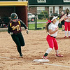 Mark Maynard | for The Herald Bulletin<br /> A Tiger batter loses her race to first base during the opening game of the High School Girls' Softball County Tourney.