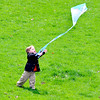 John P. Cleary |  The Herald Bulletin<br /> Zayden Elliott, 3, was with family for an outing at Shadyside Park Tuesday to fly a kite for the first time. As the breeze lifted the kite skyward little Zayden was more interested in chasing the kite trying to catch it instead of flying it.