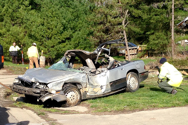 Stu Hirsch | The Herald Bulletin<br /> The Madison County Sheriff Department's accident investigation team documents the scene of the accident that caused a gas leak in Alexandria on Friday morning.