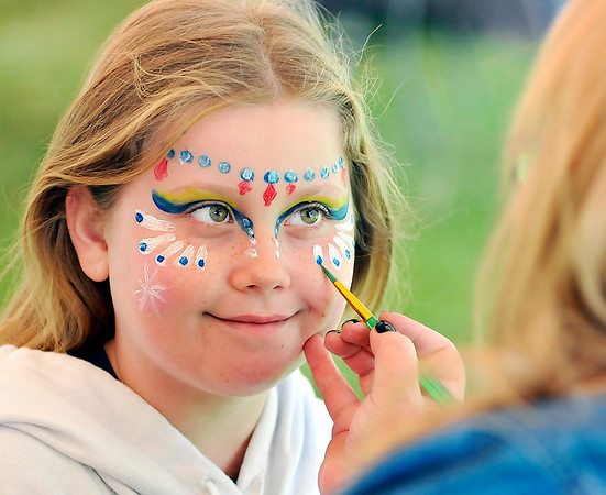 John P. Cleary |  The Herald Bulletin<br /> Lacey Snead, 8, gets her face painted while attending the Anderson Parks & Recreation Department's Earth Day/Arbor Fest activities Saturday at Shadyside Park.