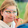 John P. Cleary    The Herald Bulletin<br /> Lacey Snead, 8, gets her face painted while attending the Anderson Parks & Recreation Department's Earth Day/Arbor Fest activities Saturday at Shadyside Park.