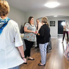 John P. Cleary |  The Herald Bulletin<br /> Libby Parker, center, executive director Beauty for Ashes, greets people during a open house Wednesday for their new education center.
