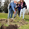 John P. Cleary | The Herald Bulletin  <br /> Anderson Mayor Thomas Broderick Jr. gets help from Jayden Thomas, 10, Mea Rodgers, 10, and Madison Baker, 10, in planting this red maple tree in Shadyside Park during the City of Anderson ArborFest celebration Saturday.