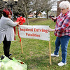 Don Knight | The Herald Bulletin<br /> From left, Christy Pearson-Jones and Anya Nealeigh decorate Citizen's Plaza Park in memory of victims of homicide or death by impaired drivers.