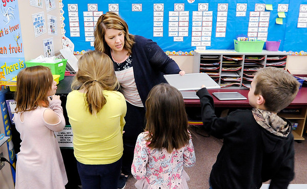 Don Knight   The Herald Bulletin<br /> Meghan Hersberger hands out Chromebooks to her first grade students at Frankton Elementary School on Friday.