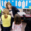 Don Knight | The Herald Bulletin<br /> Meghan Hersberger hands out Chromebooks to her first grade students at Frankton Elementary School on Friday.