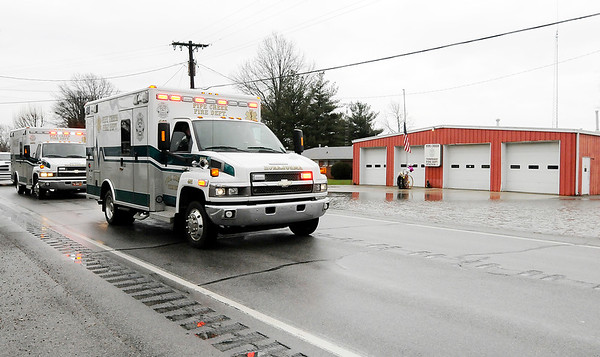 Don Knight   The Herald Bulletin<br /> A pair of Pipe Creek ambulances pass Pipe Creek Station One as they return the bodies of fallen firefighters Kyle Hibst and David Wittkamper to Elwood as part of a procession that included agencies from around the county on Tuesday.