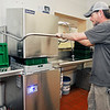 John P. Cleary | The Herald Bulletin  <br /> Timothy Breland, resident assistant kitchen manager The Christian Center, uses the new commercial dishwasher that has just been recently installed.