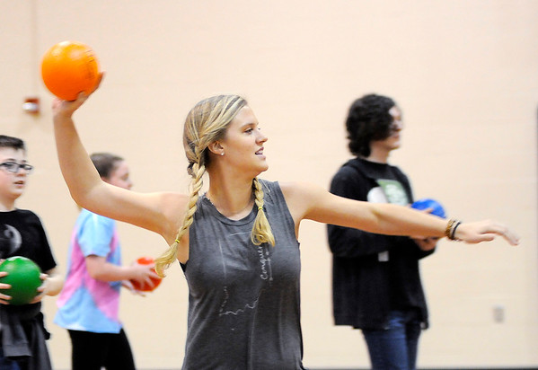 Don Knight | The Herald Bulletin<br /> Esta Henderson plays dodgeball with kids in the More Than Conquerors after school program at Pendleton Intermediary School on Tuesday.