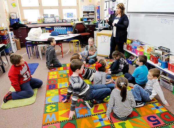 Don Knight | The Herald Bulletin<br /> Meghan Hersberger gives directions to her first grade students after they finished an online quiz at Frankton Elementary School on Friday.