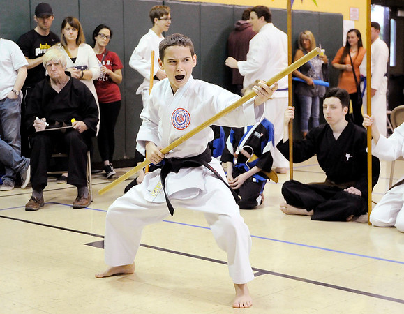 Don Knight | The Herald Bulletin<br /> Dylan Shelley, a student at Adamson's Karate in Bergersville, uses a staff as he competes in weapons kata during a tournament at Edgewood Elementary on Saturday.