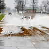 John P. Cleary | The Herald Bulletin<br /> This is along 5500 N County Road 500W where high water is across the roadway and depositing debris from the fields as it runs across the roadway.
