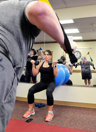 John P. Cleary | The Herald Bulletin<br /> Kristin Tomich, corporate health consultant, leads the  St. Vincent Anderson fitness class for employees that is part of their WellnessWork program.