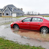 John P. Cleary | The Herald Bulletin<br /> Heavy rains surrounded this house and car by water in the 2600 block of County Road 475W.