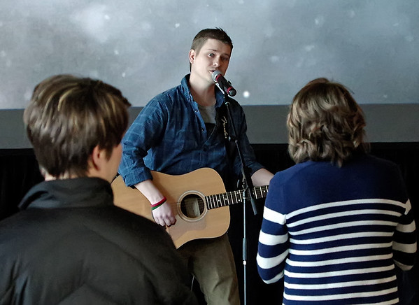 Key Worship Leader Ryan Dick performs an inspirational song during the Palm Sunday service at Harvest Bible Chapel.