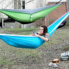 Don Knight | The Herald Bulletin<br /> Brielle Boynton, a Christian ministries student at Anderson Univiersity, takes advantage of the warm weather on Friday to relax in her hammock in the valley.