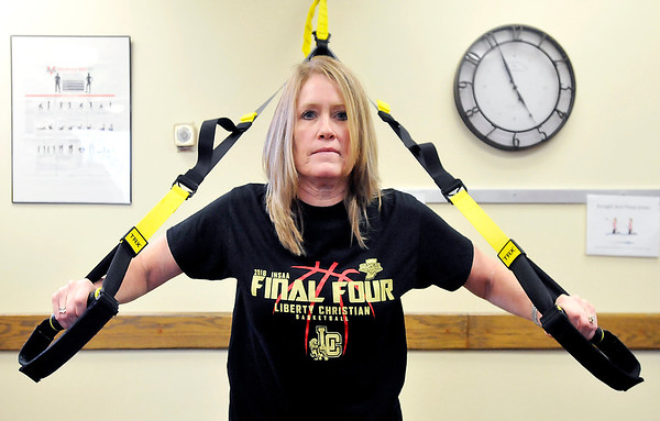 John P. Cleary | The Herald Bulletin<br /> Stacy Harmon, executive assistant to VP of Operations, does one of the exercises during the  St. Vincent Anderson fitness class for employees.