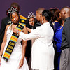 Don Knight | The Herald Bulletin<br /> Sierra Bailey receives her Kente Cloth from her parents as a right of passage during the Debutante Cotillion/Beautillion Militaire Program at Reardon Auditorium on Saturday.