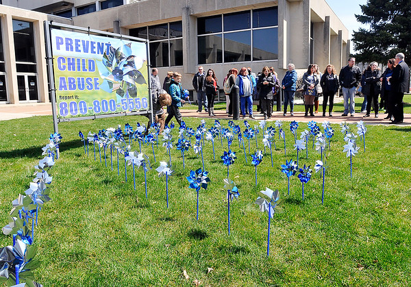 John P. Cleary | The Herald Bulletin  <br /> A pinwheel garden was planted on the front lawn of the Anderson City Building Thursday during the kickoff of National Child Abuse Prevention Month.