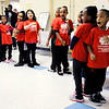 "Don Knight | The Herald Bulletin<br /> Students from the Excel Learning Academy recite ""I am Somebody"" during the Sweet Sixteen Neighborhood roll out event at the Impact Center on Saturday."