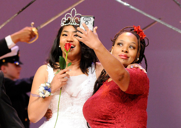 Don Knight   The Herald Bulletin<br /> Kalahni Merritt reacts as her mother snaps a photo during their introduction at the Debutante Cotillion/Beautillion Militaire Program at Reardon Auditorium on Saturday.