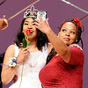 Don Knight | The Herald Bulletin<br /> Kalahni Merritt reacts as her mother snaps a photo during their introduction at the Debutante Cotillion/Beautillion Militaire Program at Reardon Auditorium on Saturday.